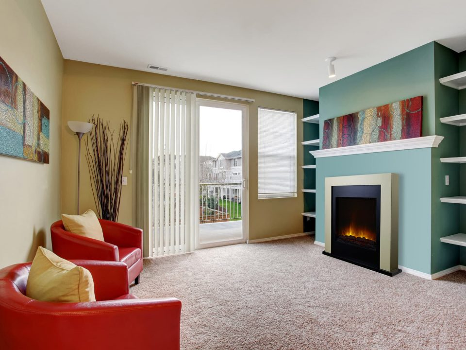 Carpet and fireplace in living room